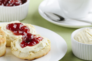 Whip the cream to a smooth but stiff consistency and serve with your favourite jam